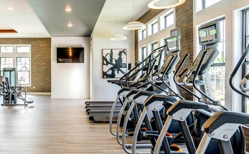 cardio and weight training machines in fitness center